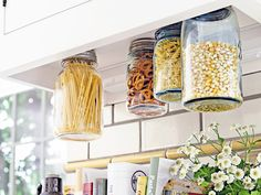 Hanging Kitchen Storage...for a few items maybe.  100 Clever Ways to Repurpose Mason Jars via Brit + Co.