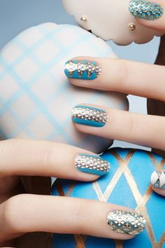 Blue with gold accents nails.