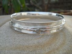 Sterling silver spinner bangle with two spinners by Inofa on Etsy