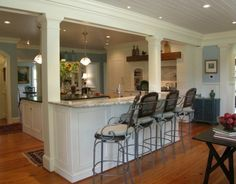 Traditional Island Style Teal kitchen, white cabinets, Chip Knuth and Audrey Newsome,