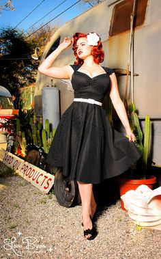 """Heidi Dress in Black Pin Dot by Pinup Couture - Our """"Heidi is the cute sister dress of our Natasha dress. Perfect for any season, this mini swing pinup dress combines the 1950's pinup with a modern twist with the shorter hem swing skirt. The Heidi pinup dress is made from the highest quality stretch sateen that hugs all of your curves with white contrast piping and matching slide belt."""
