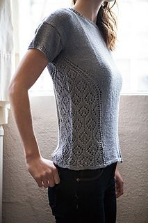 Delicate lace inserts on both sides add a soft, feminine touch to this practical tee. The sloping line of decoration draws the eye and creates a slimming effect regardless of the straight sides and positive ease.