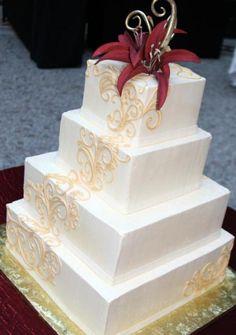 The Liz-   Buttercream wedding cake with gum paste flowers.