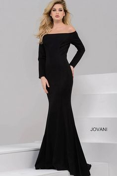 Elegant and simple floor length form fitting black evening gown with exposed zipper on the back features off the shoulder neckline and long sleeves.