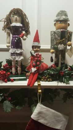 Hanging out on the mantle.. With her nutcracker friends.