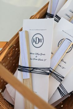 Oooh ~ we like this idea! Wrap the fans and the programs together for just that extra little oomph! Photography by comfortstudio.com, Wedding Planning by tropicaloccasions.com