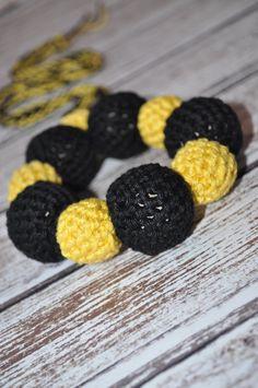 Go Hawkeyes!!!  I had to make this since my hubby is a Hawkeye alumni:) #crochetbeadnecklace #teeethingnecklace #nursingnecklace #teething #ecofriendlybaby #ecofriendlybabytoy #teethingring #hawkeyes