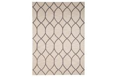 Truly going with the flow, the trellis-design Lauder area rug offers a look that can transition from contemporary to classic spaces with the greatest of ease. Muted, neutral hues and an all-wool, hand-tufted pile simply delight.