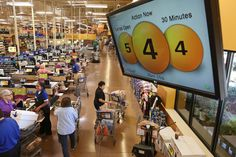 At this Cincinnati Kroger, supervisors monitor a system that says how many lanes need to...
