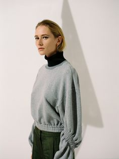 Juslin Maunula rouched sleeve sweater SS18, photo Osma Harvilahti
