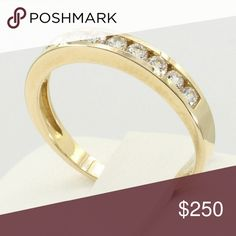 14k Solid Yellow Gold Wedding Band ?  ?Brand New 14k Yellow Gold Channel Set Round man made diamond Bridal Wedding Anniversary Ring Band. Nicely polished and shiny. Stamped with 14k for authenticity. 14k Gold, NOT PLATED NOT FILLED. Stamped with 14K for authenticity 14K Gold, NOT PLATED  Total Carat(s) 0.35 Ct. Stone is Round cut man made diamond in 14K Yellow Gold Size 7 *(Available Sizes?5 ~ 9 ) Top Width 2.5mm Weight approximately 2.3 Gr. Jewelry Rings