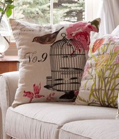 Painterly renditions of a bird perched on a birdcage, floral and script decorate this pillow from Country Curtains.