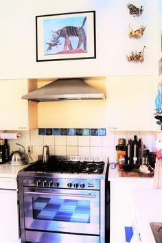 Art in kitchen.