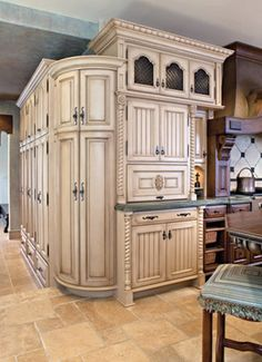 THis is the Corner Cabinet YES SIREE BOB!!!   curved kitchen cabinets in which there is a refrigerator and additional storage shelves