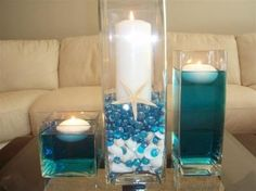 How can we decorate these for centerpieces (beach theme) :  wedding beach wedding reception centerpieces aqua ivory 400x400 1292368824651 BeachCenterpiece013Small