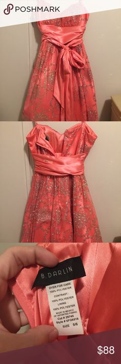 B. Darlin Prom/Formal Dress size 5/6 above knees Coral/Pink color with silver glittery floral detail. Goes right above the knees. Has tulle underneath to make it puffy! Has a satin tie around the waist. Spaghetti straps. Only wore once for prom, in perfect condition! B Darlin Dresses Prom