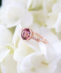 When I say that Jacob designs each of our rings to the exact proportions of the center stone, this is what I'm talking about! ✨ The stunning octagonal Pink Tourmaline from California was precision cut by an American craftsman and is perfectly complimented by the delicate Art Deco details of the ring. This is a ring fit for a queen!  ✨