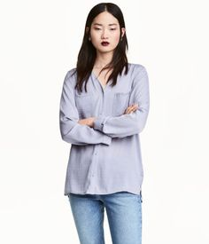 Lavender. V-neck blouse in woven fabric with a sheen. Buttons at front, two chest pockets, and long sleeves with narrow cuffs. Pleat at back and slits at