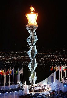 The Olympic flame burns at Rice-Eccles Stadium. Salt Lake City hosted the 2002 Winter Olympics.