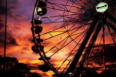 Sunset behind the ferris wheel.