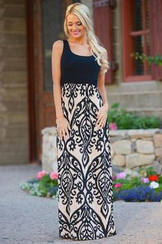One of our best sellers! Designed by Chris for the ultimate dress in style and comfort! Sleeveless maxi dress with solid black top and damask print bottom.This