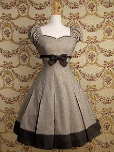 The sleeves! The bow! The skirt! The shoes that would go with this would be EPIC.