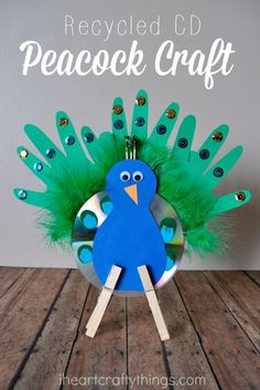 Turn an old CD into this pretty Recycled CD Peacock Craft for Kids. I get so excited every month when the Kids Craft Stars challenge comes along. Last month we made crafts based on children's books and this month we are using a CD to create a children's Kids Crafts, Fall Crafts For Kids, Projects For Kids, Art For Kids, Arts And Crafts, Spring Crafts, Preschool Crafts, Art Projects, Recycled Cd Crafts