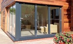 Here's all you need to know about bifold doors, including how much they cost and how to choose the right material for your installation Aluminium Sliding Doors, Palette, Folding Doors, Living Room Kitchen, Open Concept, French Doors, Building A House, Gq, Home And Garden