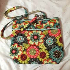 """Vera Bradley Tota VERA BRADLEY TOTE IN FLOWER SHOWER •Perfect for a day trip or overnight! •Lightly used but in great condition!✨ •11 3/4"""" W x 13 1/2"""" H x 4"""" D - 12 1/2"""" strap drop •Fast Shipping! •10% off bundle discount! Always! •Any questions? Ask away! Happy Poshing! Vera Bradley Bags Totes"""