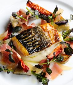 Matthew Tomkinson uses sea bass as the centrepiece to a lavish salad, serving with both globe and Jerusalem artichokes and a red wine sauce.