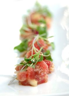 Tuna Tartare  I must have raw fish in any meal. I do this over and over again because it's simple and tasty. No need to suffer any burns or missing digits with this appetizer. A few drops of soy sauce, fresh apples and a dash of sesame oil and you have a take on a famous hawaiian poké dish.
