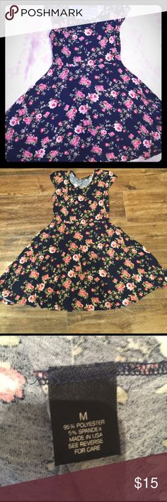 FLORAL DRESS A gentle used floral dress w/ cap sleeves. Navy blue. A fun addition to your closet for Spring into Summer. Waist laying flat measures 13 inches across. Length of dress measures 31 inches. Stretches in the right spots and flowing at the bottom. Very flattering! Wet Seal Dresses