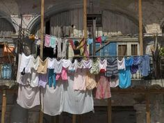 size: Photographic Print: Large Quantity of Laundry Hanging from the Balcony of a Crumbling Building, Habana Vieja, Cuba by Eitan Simanor : Artists Cuba, Leaving Home, Novelty Gifts, Hanging Out, Find Art, Framed Artwork, Custom Framing, Balcony, Pure Products
