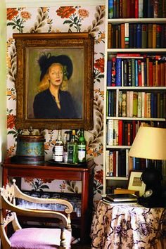 Inside Nicky Haslam's Hunting lodge/country house, once the lodge of Tudor king Henry VII. The anteroom off the sitting room, with a portrait of Haslam's mother by the Scottish painter Robin Guthrie.