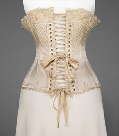 Wedding corset - back view, 1881-82 via the Brooklyn Museum Costume Collection at The Metropolitan Museum of Art, Gift of the Brooklyn Museum, 2009; Gift of Mrs. M. Disbrow, 1944