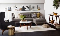 basically the same as our new couch. I could make a smaller version of that table - marble top, wooden legs, brass caps.