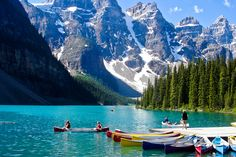 Canoe in Peyto Lake.  Peyto Lake is a scenic location on the Icefields Parkway about 40 kilometers north of the town of Lake Louise.