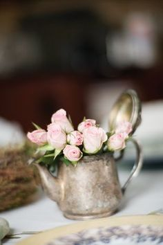 Tiny pink roses in a silver tea pot. Picture from: Peeking thru The Sunflowers: Happy Monday!