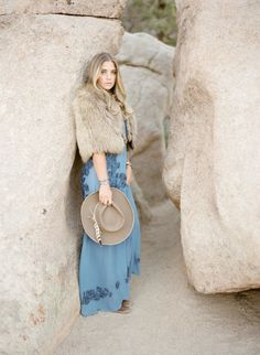 Bohemian dusty blue maxi dress and fur jacket: http://www.stylemepretty.com/2016/09/19/joshua-tree-engagement-session/ Photography: KT Merry - https://www.ktmerry.com/