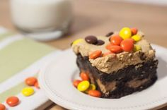 Fudgy peanut butter cup stuffed brownies with peanut butter frosting