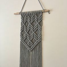 Macrame Wall hanging | Angles | Modern, geometric, minimalistic, grey. by WallflowerAndWyatt on Etsy https://www.etsy.com/au/listing/527334622/macrame-wall-hanging-angles-modern