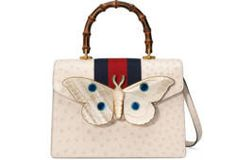 Ostrich top handle bag with moth