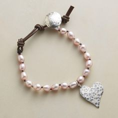"PEARL PANACHE BRACELET -- Not so demure cultured pearls, in blushing pink, knotted on dark brown leather with a hand-hammered sterling silver heart and button closure. Handcrafted in USA. Exclusive. Adjustable, 6-1/2"" to 7-1/2""L."