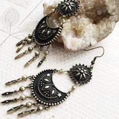 """❤️reduced 40%   my sun, my moon, my stars earrings JUST REDUCED from $20. """"Yours is the light by which my spirit's born: - you are my sun, my moon, and all my stars."""" - E.E. Cummings. These antiqued bronze finish earrings add just the perfect amount of bohemian flair to any outfit.   Measures: length   3-3/4"""" width   1-1/8""""  ❤️❤️>> we're kicking off this season of giving with a BIG SALE... all prices have been reduced 40% (prices as shown, no additional discounts). free shipping at…"""