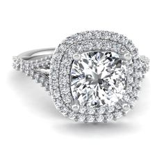 Double Halo Split Shank Design With Pave Diamonds Accenting A Cushion Cut Diamond Center Stone