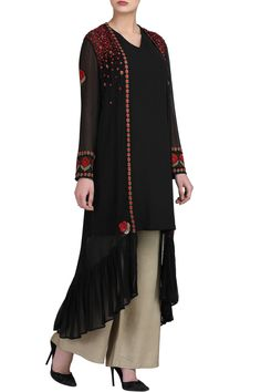 Black cape with slip and beige trousers