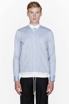 SACAI //  Blue chambray drawstring hem shirt  32445M040005  Long sleeve chambray shirt in blue. Contrasting spread collar. Press-stud closure and patch pocket at front. Contrasting elasticized hem in white with tonal drawstring. Tonal stitching. Single press-stud at barrel cuffs. Body: 100% cotton. Trim: 100% polyester. Hand wash. Imported.  $370 CAD