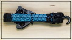 The AQUA BLUE strap has a bright blue polyester stretch cover with black stripes. Blue like the ocean. Which is fitting because in addition to being UV-resistant and ozone-resistant, all our straps are also marine-resistant. The remainder of the strap is black polyester webbing. Get a package of two straps for only $19.95!