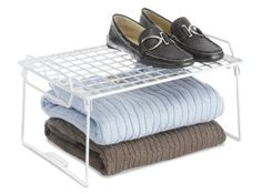 Whitmor 6023-3982 Stacking Utility Shelf by Whitmor. $11.99. Smooth surface. Stacks to save space. Folds to store. Increase your storage space with Whitmor's stacking utility shelf. This handy folding white wire shelf is made of a durable white resin coated metal forming a smooth breathable wire grid for storing almost any item. It can be used anywhere in your home, office, or dorm room where you need to organize and increase shelving space. You can stack multiple shel...