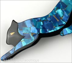 "Description: Signed Lea Stein figural panther brooch, cellulose acetate. Designer/Makers Marks, Hallmarks, Tags: Lea Stein Paris. Age: Circa 1990's-2000's. Dimensions: 4""x1.5"". Condition: Excellent un"